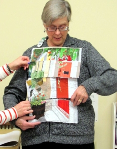 Jean E. models the second fractured photo quilt created for the Art Group Challenge