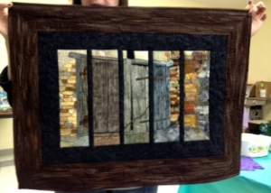 The framed barn door, created for the Art Quilt Challenge by Noreen, Paulette, Edith, Rosalie and Kristina.