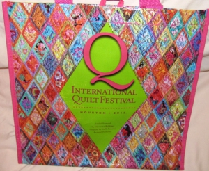 A tote bag featuring a detail from Tina's award winning quilt.