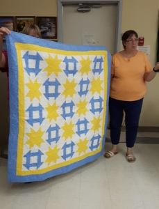 Heather's eye popping blue and yellow shoofly quilt